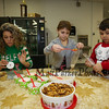 """Elfie"" Linda Durant with 2nd graders Ella O'Brien and Nolan Durant make bags of, ""reindeer food"" at the 2017 Annual Hampton PTA Breakfast with Santa on Saturday @ Hampton Academy on 12-9-2017.  Matt Parker Photos"