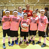 "Dana Farber volunteer Program organizer Kristen Underwood and cancer survivor Lindsay McAlpine pose for a photo with the ""Tough Guys Wear Pink!"" 5th-6th grade basektball team who won the, ""Best Team Name"" award at Saturday's 2017 Dana Farber Marathon Challenge 3-on-3 Basketball fundraising tournament at Portsmouth High School on 2-4-2017.  Matt Parker Photos"