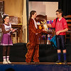 "The school mascot Darby the Squirrel (played by Riley Wall), convinces Bronco an opposing football player (played by Sam Hackett) to hand over their mascot (the dog) with cheerleader Terry (played by Emeri Jacobs) waiting to get an autograph during a scene from the play, ""Just For Kicks"" by Patrick M. Cleeper's as performed by the The Hampton Academy Players on Friday 3-17-2017 @ Hampton Academy.  Matt Parker Photos"