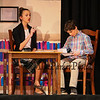 "English Teacher Janet Talber (played by Riley Demotses) discusses a paper with Tommy (played by Jake Ciolfi) during a scene from the play, ""Just For Kicks"" by Patrick M. Cleeper's as performed by the The Hampton Academy Players on Friday 3-17-2017 @ Hampton Academy.  Matt Parker Photos"