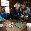 """Barb Cutting (L) and Staci Zaker pouring mape sugar sugar candy into maple leaf molds at the Lincoln Akerman School 4th grade """"Sugaring-Off"""" Maple Syrup Party on Saturday 3-25-2017 @ Hampton Falls, NH.  Matt Parker Photos"""