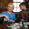 "4th grader Maverick Wickson with Shea Olofson pour maple syrup samples at the Lincoln Akerman School 4th grade ""Sugaring-Off"" Maple Syrup Party on Saturday 3-25-2017 @ Hampton Falls, NH.  Matt Parker Photos"