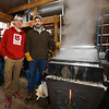 "Nick Roderick and maple sugar house operator and 4th grade teacher Jim Cutting pose for a photo with the maple sap evaporator at the Lincoln Akerman School 4th grade ""Sugaring-Off"" Maple Syrup Party on Saturday 3-25-2017 @ Hampton Falls, NH.  Matt Parker Photos"