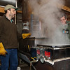 "Maple sugar house operator and 4th grade teacher Jim Cutting (L) monitors the sap evaporation process with assistant Scott Elzey at the Lincoln Akerman School 4th grade ""Sugaring-Off"" Maple Syrup Party on Saturday 3-25-2017 @ Hampton Falls, NH.  Matt Parker Photos"