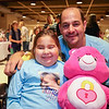 9 yeare old Ciara Brill and her father Harold pose for a photo with a pink suffed bear at  Sunday's benefit for Ciara who was diagnosed with DIPG,  brain cancer, with family, friends and community on 3-26-2017 @ Portsmouth High School.  Matt Parker Photos