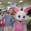 "3rd grader Lucca Rogers poses for a photo with the Easter Bunny and holds a ""golden egg"" which she traded for a box of sidewalk chalk at the Brentwood Recreation Department Egg Hunt and Easter Bunny Breakfast on Saturday 4-15-2017, Brentwood, NH.  Matt Parker Photos"