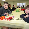 8th grader Alex Litchfield with kindergartner brother  Jake with their pile of Bunny candy at the Brentwood Recreation Department Egg Hunt and Easter Bunny Breakfast on Saturday 4-15-2017, Brentwood, NH.  Matt Parker Photos