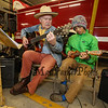 TJ Wheeler, President of the Friends of the Hampton Falls Bandstand, plays guitar while 7th grader Felix Taracena strums the ukulele at the 2017 Earth Day Jam and Chicken BBQ with Friends of the Hampton Falls Bandstand on Saturday 4-22-2017 @ Hampton Falls Fire Department, NH.  Matt Parker Photos