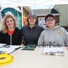 Morgan Clinard, Isabella Sawyer and Jayne Hitchcock work at the registration table at The 6th Annual Chief Maloney Unity Run 10K to honor our communities' first responders on Sunday 4-30-2017, Greenland, NH.  Matt Parker Photos