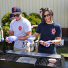 Anthony Colarusso and Beth Mason cook up the burgers at the 6th Annual Chief Maloney Unity Run 10K to honor our communities' first responders on Sunday 4-30-2017, Greenland, NH.  Matt Parker Photos