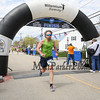 Tom Raffio of Bow NH, crosses the finish line with a time of 58:28 at the 6th Annual Chief Maloney Unity Run 10K to honor our communities' first responders on Sunday 4-30-2017, Greenland, NH.  Matt Parker Photos