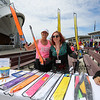 Volunteers Nancy Rowe and Danielle Marlotte were offering kites for a donation at the Kites Against Cancer to benefit The Beyond the Rainbow Fund of Exeter Hospital on Sunday at the Seashell Stage, Hampton Beach on 5-21-2017.  Matt Parker Photos