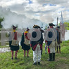 The New Hampshire Colonial Brigade Militia fires there muskets over the Squamscott River at the Newfields Landing during Newfields Memorial Day ceremony and parade on Saturday 5-27-2017.  Amy Sununu and Natalie Fream Photos
