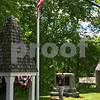 The 2017 Grand Marshal Jack Shaw Captain, US Air Force raises the flag in Badger Park at the Newfields Memorial Day ceremony and parade on Saturday 5-27-2017.  Amy Sununu and Natalie Fream Photos