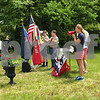 Newfields resident Patty Brown leads the pledge allegiance at the Newfields Memorial Day ceremony and parade on Saturday 5-27-2017.  Amy Sununu and Natalie Fream Photos