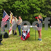 Newfields resident Patty Brown sings the National Anthem at the Newfields Memorial Day ceremony and parade on Saturday 5-27-2017.  Amy Sununu and Natalie Fream Photos