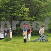 The New Hampshire Colonial Brigade Militia prepares to fire the cannon at the Newfields Memorial Day ceremony and parade on Saturday 5-27-2017.  Amy Sununu and Natalie Fream Photos