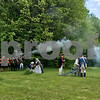 The New Hampshire Colonial Brigade Militia fires the cannon in salute at the Newfields Memorial Day ceremony and parade on Saturday 5-27-2017.  Amy Sununu and Natalie Fream Photos