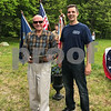 The 2017 Grand Marshal Jack Shaw Captain, US Air Force receives an honorary slate from John Loosman at the Memorial Day ceremony and parade on Saturday 5-27-2017.  Amy Sununu and Natalie Fream Photos