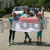 Local Girls Scouts lead the parade introducing the 2017 Grand Marshal Jack Shaw Captain, US Air Force at the Newfields Memorial Day ceremony and parade on Saturday 5-27-2017.  Amy Sununu and Natalie Fream Photos