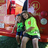 Riley Gay and 7th grade York Middle School student Carlie Welch pose for a photo while sitting on the bumber of the Squad 41 rescue truck at the York Beach Fire Department Annual Parade and Muster on Sunday 6-25-2017, York Beach, ME.  Matt Parker Photos