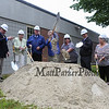 """SAU 90 officials conclude the groundbreaking ceremony with shovels full of sand (L to R), Nathan Lunney, Business Administrator Kathleen Murphy, Superintendent Les Shepard, School Board Chair Andrea Shepard, Ginny Bridle-Russell, Frank Deluca and Charlotte """"Peppa"""" Ring at the Hampton Academy Groundbreaking-reconstruction ceremony on a rainy Monday 7-24-2017, Hampton, NH.  Matt Parker Photos"""