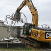 A Cat 336E excavator removes the walls of the 6th grade addition at the Hampton Academy Groundbreaking-reconstruction ceremony on Monday 7-24-2017, Hampton, NH.  Matt Parker Photos