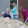 Students dig a shovel full of sand at the Hampton Academy Groundbreaking-reconstruction ceremony on a rainy Monday 7-24-2017, Hampton, NH.  Matt Parker Photos