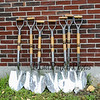 Groundbreaking chrome plated ceremony shovels rest agianst a wall soon to be torn down at the Hampton Academy Groundbreaking-reconstruction ceremony on a rainy Monday 7-24-2017, Hampton, NH.  Matt Parker Photos