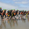 "The, ""1st Wave"" heads to the water at the 2017 Nubble Light Challenge, 2.4 mile swim from Long Sands around the Nubble Lighthouse finishing at Short Sands Beach on Saturday 8-12-2017, York Beach, ME.  Matt Parker Photos"