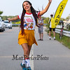 Katie Stamas of Tyngsborough, MA poses for a photo while showing off her multi-colored braids at the 2017 40th Annual Saunders at Rye Harbor 10k road race to benefit the New Hampshire SPCA on Thursday 8-17-2017, Rye, NH.  Matt Parker Photos