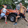 Mike Barry and Thomas Mason get in a stretch prior to the start of the 2017 40th Annual Saunders at Rye Harbor 10k road race to benefit the New Hampshire SPCA on Thursday 8-17-2017, Rye, NH.  Matt Parker Photos