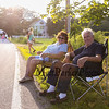 Carol and Gil Martin of Rye, NH found front row seats at the 2017 40th Annual Saunders at Rye Harbor 10k road race to benefit the New Hampshire SPCA on Thursday 8-17-2017, Rye, NH.  Matt Parker Photos
