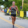 One of my favorite runners Laura Parker #418 of Eliot, ME completes the 10k race in a time of 1:08:05.4 at the 2017 40th Annual Saunders at Rye Harbor 10k road race to benefit the New Hampshire SPCA on Thursday 8-17-2017, Rye, NH.  Matt Parker Photos