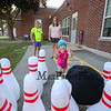 Preschooler Laylah Nichols throws a jumbo bowling ball at the pins with her mom Jody and 6th grade sister Haleigh looking on at the Lane Library Summer Reading Finale party and celebration on Thursday 8-3-2017 @ Centre School, Hampton, NH.  Matt Parker Photos