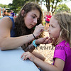 Winnacunnet Senior Michaela Maloney performs her magic as she paints the face of 1st grader Alexa Wilcox at the Lane Library Summer Reading Finale party and celebration on Thursday 8-3-2017 @ Centre School, Hampton, NH.  Matt Parker Photos