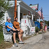 6th grader Tanner Smith and 8th grader Maddy Cooper sit outside on a bench in front of the famous Lindy's Country Store at the Brentwood's 275th Celebration Parade on Sunday 9-17-2017, Brentwood, NH.  Matt Parker Photos