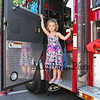 Nell Paige stands in the door of an Exeter fire truck at the Exeter Police and Fire Department Open House at the Exeter Safety Complex on Saturday 9-23-2017 @ Exeter, NH.  Matt Parker Photos