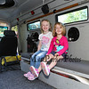 """(L to R) Avery Morlock and friend Aubrey Bourget enjoy sitting on the bench seats in the SERT """"Bearcat"""" emergency vehicle at the Exeter Police and Fire Department Open House at the Exeter Safety Complex on Saturday 9-23-2017 @ Exeter, NH.  Matt Parker Photos"""