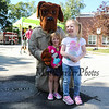 Friends Aubrey Bourget and Avery Morlock pose for a photo with McGruff the crime dog  at the Exeter Police and Fire Department Open House at the Exeter Safety Complex on Saturday 9-23-2017 @ Exeter, NH.  Matt Parker Photos