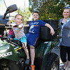 Preschooler Henry Uden is in the drivers seat of Exeter's ATV with 4th grade brother Jack and Mom Laura at the Exeter Police and Fire Departments Open House  Open House at the Exeter Safety Complex on Saturday 9-23-2017 @ Exeter, NH.  Matt Parker Photos