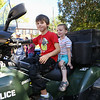 3rd grader Shepard and younger brother preschooler Henry Uden sit on the Exeter's ATV at the Exeter Police and Fire Departments Open House  Open House at the Exeter Safety Complex on Saturday 9-23-2017 @ Exeter, NH.  Matt Parker Photos