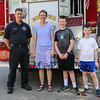 FirefighterTimothy Sirois poses for a photo with Stephanie Stewart with 5th grader Issac and 3rd grader Caroline at the Exeter Police and Fire Department Open House at the Exeter Safety Complex on Saturday 9-23-2017 @ Exeter, NH.  Matt Parker Photos