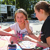 Sophmore Hannah Munck paints the face of 4th grader Maeve Paige at the Exeter Police and Fire Department Open House at the Exeter Safety Complex on Saturday 9-23-2017 @ Exeter, NH.  Matt Parker Photos