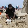 "Marc Lepire of Quebec Canada carves, ""Wind Lovers"" at the 18th Annual Hampton Beach Master Sand Sculpting Classic on Saturday June 16, 2018, Hampton Beach, NH.  Matt Parker Photos"