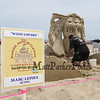 """Marc Lepire of Quebec Canada carves, """"Wind Lovers"""" at the 18th Annual Hampton Beach Master Sand Sculpting Classic on Saturday June 16, 2018, Hampton Beach, NH.  [Matt Parker/Seacoastonline and Fosters.com]"""