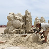 "Justin Gordon of Massachusetts carves, ""Defeating The Darkness"" at the 18th Annual Hampton Beach Master Sand Sculpting Classic on Saturday June 16, 2018, Hampton Beach, NH.  [Matt Parker/Seacoastonline and Fosters.com]"