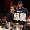 "Kaylah Riley and Cody Freeman of, ""The Farm"" show off their farm style chili at the 2018 Hampton Firefighters Toy Bank Annual Chili Cook Off on Thursday at Wally's Pub on 11-15-2018, Hampton Beach, NH.  Matt Parker Photos"