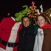 "Lisa Parker of Hampton (center) with, ""The Grinch"" and his, ""Dog Max"" pose for a photo at the lighted tree at Fox's Lobster House at the annual Lighting of the Nubble Lighthouse presented by the Town of York, Maine on Saturday 11-24-2018, Sohier Park, York Beach, ME.  [Matt Parker/Seacoastonline]"