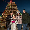 Scott Terrien with his family (L to R) Teri, 4th grader Alexandra and 11th grader Sara in front of the Fox's Lobster House lobster trap Christmas Tree at the the annual lighting of the Nubble Lighthouse presented by the Town of York, Maine on Saturday 11-24-2018, Sohier Park, York Beach, ME.  Matt Parker Photos